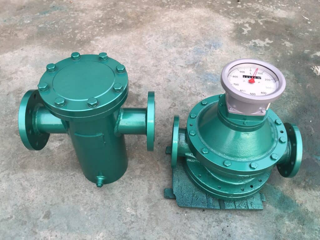 Oval gear flow meter and filter